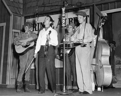 This Nov. 1943 file photo shows Roy Acuff, second from left, performing with the Smoky Mountain Boys at the Grand Ole Opry in Nashville, Tenn. From left are Lonnie Wilson, Acuff, Jimmy Riddle, Pete Kirby, and Velma Williams, partially hidden behind Kirby. In July 2012, a fiddle once belonging to Acuff will be displayed at the Museum of East Tennessee History's