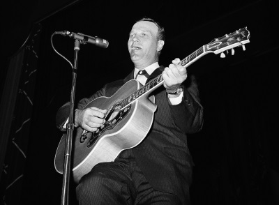 In this June 8, 1959 file photo, Eddy Arnold performs at the Rotary International Convention in Madison Square Garden in New York. Arnold, whose mellow baritone on songs like