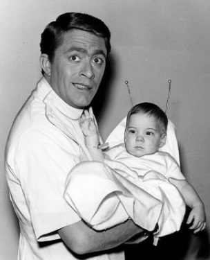 Photo of Bill Bixby as Tim O'Hara from the television program My Favorite Martian. In this episode, an accident with a rejuvenation bulb takes Uncle Martin (played by Ray Walston) back to babyhood.(Wikimedia Commons/CBS Television)