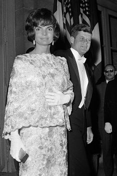 First lady Jacqueline Kennedy, wearing a pink and white straw lace dress designed by Oleg Cassini and U.S. President John F. Kennedy leave the Quai D'Orsay ministry for the Elysee Palace reception during their official visit in Paris, France, in this May 31, 1961 photo. (AP Photo)