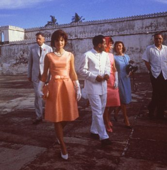 First lady Jacqueline Kennedy, center, tours the Palace of the Maharajah in Udaipur, India, wearing an apricot silk ziberline dress by Oleg Cassini during a state visit to India on March 17, 1962. (AP Photo/John F. Kennedy Library and Museum)