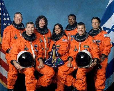 Official crew photo from mission STS-107 on the Space Shuttle Columbia. From left to right are mission specialist David Brown, commander Rick Husband, mission specialist Laurel Clark, mission specialist Kalpana Chawla, mission specialist Michael Anderson, pilot William McCool, and Israeli payload specialist Ilan Ramon. (Wikimedia Commons/NASA)