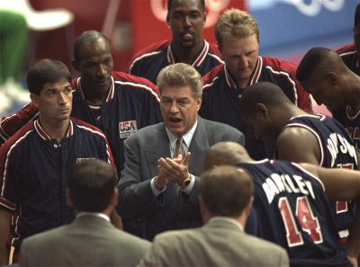 USA basketball coach Chuck Daly talks with the team during their preliminary round basketball game with Croatia at the Summer Olympics in Barcelona Monday, July 27, 1992. (AP Photo/Ed Reinke)