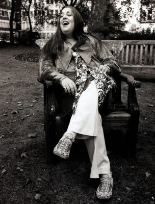 London, England, 24th October 1969, American singer 'Mama' Cass Elliott is pictured sitting on a park bench (Photo by Popperfoto/Getty Images)
