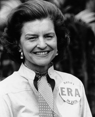 In this Feb. 26, 1975 file picture, first lady Betty Ford wears an Equal Rights Ammendment button given to her by demonstrators at the hotel where she was staying with her husband, President Gerald Ford, in Hollywood, Fla. Betty Ford, the former first lady whose triumph over drug and alcohol addiction became a beacon of hope for addicts and the inspiration for her Betty Ford Center, has died, a family friend said Friday, July 8, 2011. She was 93. (AP Photo)