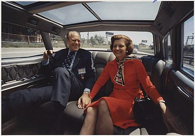 Gerald and Betty Ford hold hands in the presidential limo (Wikimedia Commons/National Archives)