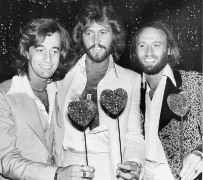In this July 31, 1978, file photo, the British pop group the Bee Gees, from left, Robin Gibb, Barry Gibb and Maurice Gibb, pose for photographers, in Los Angeles. (AP Photo/Lennox Mclendon, File)