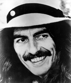 Former Beatle George Harrison smiles in this 1974 file photo at an unknown location. (AP Photo/File)