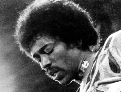 "In this 1970 file photo, Jimi Hendrix performs on the Isle of Wight in England. A new Jimi Hendrix album is coming March 5. The musician's website says ""People, Hell and Angels"" contains 12 previously unreleased tracks recorded in 1968 and '69. Rolling Stone revealed the album cover on its website Wednesday, Nov. 21, 2012.(AP Photo/file)"