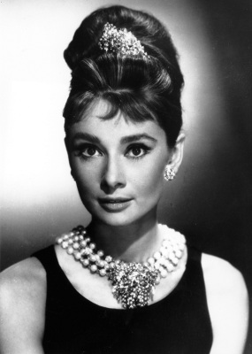 Actress Audrey Hepburn poses as Holly Golightly in the 1961 movie 'Breakfast at Tiffany's' (AP Photo)