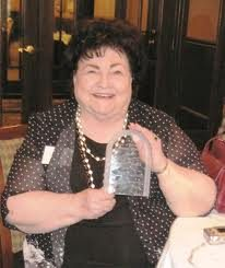 Gerry Hostetler displays her Lifetime Achievement Award from the Society of Professional Obituary Writers (Photo courtesy of SPOW)