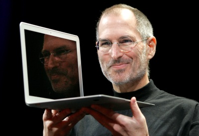 In this Jan. 15, 2008, file photo, Apple CEO Steve Jobs holds up the new MacBook Air after giving the keynote address at the Apple MacWorld Conference in San Francisco. Apple on Wednesday, Oct. 5, 2011 said Jobs has died. He was 56. (AP Photo/Jeff Chiu, File)