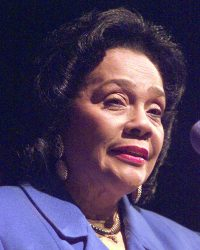 Coretta Scott King looks out over the crowd as she addresses a tribute to her late husband, slain civil rights leader Martin Luther King Jr., at the Camden County College in Blackwood, N.J., Wednesday, Jan. 20, 1999. (AP Photo/Charles Rex Arbogast)