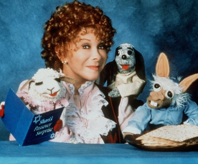 Puppeteer Shari Lewis is shown in this 1997 publicity photo for a PBS special, 'Shari's Passover Surprise.' The children's entertainer who charmed youngsters for decades with furry sidekicks Lamb Chop, Hush Puppy and Charlie Horse, died of cancer, Sunday, Aug. 2, 1998. She was 65. (AP Photo/Deb Halberstadt)