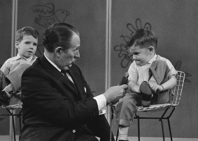 In this April 5, 1962 file photo, TV personality Art Linkletter talks with 4-year-old Ronnie Glahn shows Art Linkletter his idea of how bad guys look, on Art's TV show in Hollywood, April 5, 1962 in Los Angeles. Linkletter, who hosted the popular TV shows