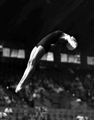 This file photo taken Aug. 2, 1948, shows Victoria Manalo Draves competing in the compulsory dives of the women's Olympic Games springboard competition in Wembley, London. Draves, the first woman to win two diving gold medals in the same Olympics and the first Asian American medal winner, has died. She was 85. Her husband and coach Lyle Draves said she died from pancreatic cancer complications on April 11, 2010, at Desert Regional Medical Center in Palm Springs, Calif. (AP Photo/File) )