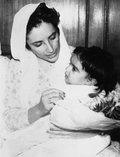 Benazir Bhutto holds her baby daughter, Bakhtwar in Karachi, seen in this May. 6, 1991, file photo. Pakistani opposition leader Benazir Bhutto, 54, was assassinated Dec. 27, 2007, in Rawalpindi, Pakistan in a suicide attack. (AP Photo)