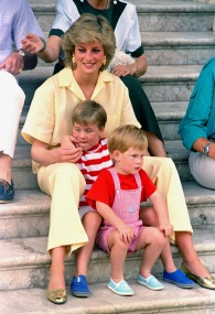 Princess Diana of Wales smiles as she sits with her sons, Princes Harry, front, and William, on the steps of the Royal Palace on the island of Majorca, Spain, Aug. 9, 1987. Princess Diana died in a Paris car crash Aug. 31, 1997. (AP Photo / John Redman)