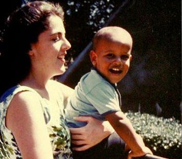 Stanley Ann Dunham holds son Barack Obama. Dunham died of uterine cancer on Nov. 7, 1995. (Photo via Facebook)