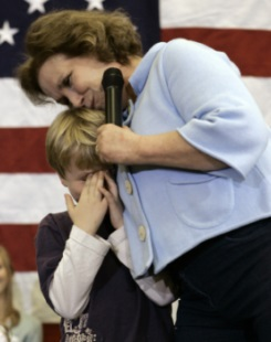 Elizabeth Edwards, wife of Democratic presidential hopeful former Sen. John Edwards, D-N.C. hugs their son Jack on stage after he was too embarrassed to talk in Ames, Iowa Tuesday, Jan. 1, 2008. Edwards died of metastatic breast cancer on Dec. 7, 2010. (AP Photo / Paul Sancya)