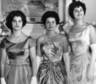 Lady Bird Johnson, center, her daughters Luci Baines, left, and Lynda Bird, right, model their inaugural gowns in New York City in this Jan. 12, 1961 file photo. Lady Bird Johnson, the former first lady who championed conservation and worked tenaciously for the political career of her husband, former President Lyndon B. Johnson, died Jul. 11, 2007. She was 94. (AP Photo)