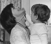 First lady Jackie Kennedy and John F. Kennedy Jr. share a moment in the White House nursery. Mrs. Kennedy died of non-Hodgkin's lymphoma on May 19, 1994; son John Jr. died in a plane crash on Jul. 16, 1999. (Wikimedia Commons / Cecil Stoughton)