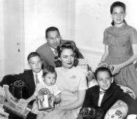 Actress Donna Reed and her family in 1959. In back are Tony Owen (Reed's husband at that time) and daughter Penny Jane. Seated with Reed from left are son, Tony, Jr., daughter Mary and son, Tim. Reed died of pancreatic cancer on Jan. 14, 1986. (Wikimedia Commons / ABC Television)