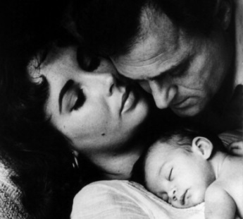 Legendary actress Elizabeth Taylor with husband Mike Todd and newborn Liza in 1957. Taylor died on Mar. 23, 2011. (Wikimedia Commons / Library of Congress)