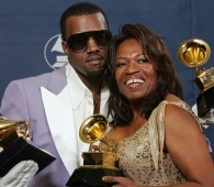 Kanye West and his mother Donda hold his three awards backstage at the 48th Annual Grammy Awards in this Feb. 8, 2006, file photo in Los Angeles. West won for best rap album, solo and song. Donda West died Nov. 10, 2007. (AP Photo / Reed Saxon)