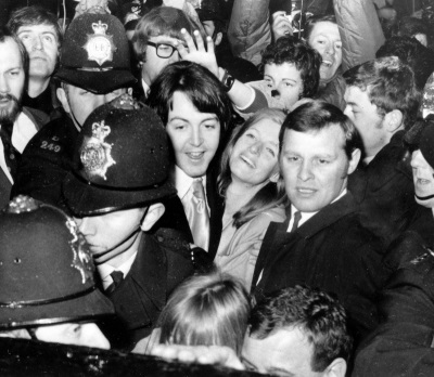 Newlyweds Paul McCartney, 26, and the American photographer formerly Linda Eastman, centre, are mobbed by a crowd of screaming fans as they are escorted by police, as the couple leave the Marylebone Town Hall Registry Office in London, after their wedding in this file photo dated March 12, 1969. (AP Photo, file)