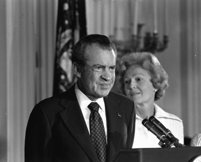 In this Aug. 9, 1974 black-and-white file photo, President Richard M. Nixon and his wife Pat Nixon are shown standing together in the East Room of the White House in Washington. Thirty-six years after Nixon testified secretly to a grand jury investigating Watergate, a federal judge orders the first public release of the transcript. (AP Photo/Charlie Harrity, File)