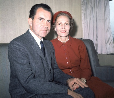 In this June 5, 1960 file photo, former President Richard Nixon, left, and his wife Pat pose for photos while campaigning at Rockefeller Center in New York. (AP File Photo)