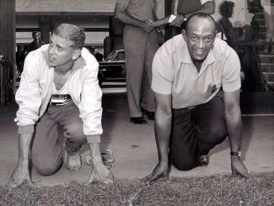 Armin Hary and Jesse Owens, the gold medalist in the 100 meter sprint in 1960 and 1936 are to report on 1 Sept. 1960 at the Olympic Village in Rome, the photographer. (AP Photo)