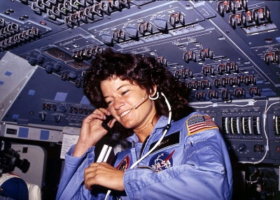 Sally Ride, America's first woman astronaut, communicates with ground controllers from the flight deck during the six day mission of the Challenger. National Aeronautics and Space Administration. (Wikimedia Commons/U.S. Information Agency)