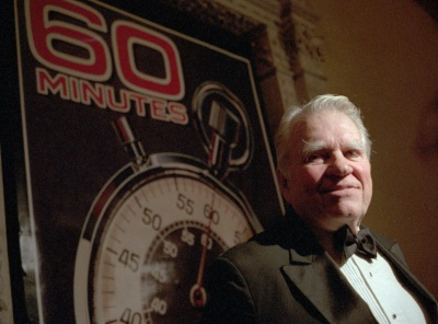 Andy Rooney, commentator and satirist for 60 Minutes, talks to newsmen at the Metropolitan Museum of Art in New York Nov.10, 1993. The popular CBS news program was holding a 25th anniversary party at the museum. (AP photo/Mark Lennihan)