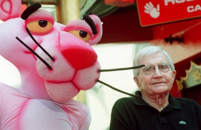 In this Sept. 28, 1999 file photo, film director Blake Edwards, right, and a person dressed as the character the Pink Panther, pose for photos after placing their hands and paws in cement in front of the Mann's Chinese Theater in the Hollywood section of Los Angeles, at the 35th anniversary celebration of