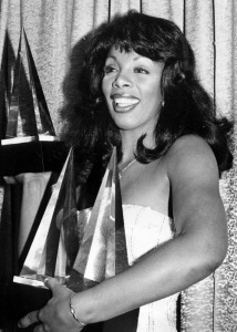 "In this Jan. 12, 1979 file photo, singer Donna Summer poses with three awards she won at the American Music Awards in Los Angeles, Calif. Summer, the Queen of Disco who ruled the dance floors with anthems like ""Last Dance,"" ""Love to Love You Baby"" and ""Bad Girl,"" has died. Her family announced her death in a statement Thursday, May 17, 2012. She was 63. (AP Photo/Nick Ut, File)"