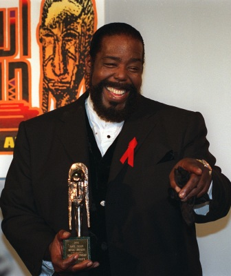 Singer Barry White, shown posing with his trophy after being honored with the Heritage Award for career acheivemnet at the eight annual Soul Train Music Awards in this March 15, 1994 photo in Los Angeles, died Friday morning, July 4, 2003, his manager said. White, who had suffered from kidney failure from years of high blood pressure, died at Cedars-Sinai Medical Center in Los Angeles around 9:30 a.m., said manager Ned Shankman. He was 58. (AP Photo/Rhonda Birndorf)