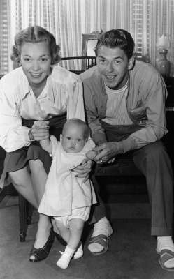 Actors Jane Wyman and Ronald Reagan, described as among Hollywood's happily-married couples, are holding their 9-month-old daughter Maureen Elizabeth, on September 13, 1941, at their Hollywood, Calif., home. (AP Photo)
