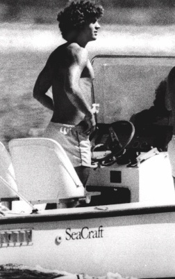 John F. Kennedy, Jr. son of the late president, spends a late summer day at the helm of a small power boat off the shore near his home in Hyannisport, Massachusetts, Sunday, Sept. l9, 1979. Come Monday, John will register as a freshman at Brown University in Providence, Rhode Island. (AP Photo)