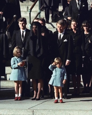 This Nov. 25, 1963 file photo shows three-year-old John F. Kennedy Jr. saluting his father's casket in Washington on Nov. 25, 1963, three days after the president was assassinated in Dallas. Widow Jacqueline Kennedy, center, and daughter Caroline Kennedy are accompanied by the late president's brothers Sen. Edward Kennedy, left, and Attorney General Robert Kennedy. (AP Photo, file)