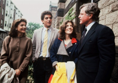 John F. Kennedy Jr., second from left, listens to his uncle Ted Kennedy, right, with his mother Jacqueline Kennedy Onassis, left, and sister Caroline Kennedy, second right, at his graduation from Brown University, Providence, R.I., in this June 4, 1983 photo. (AP Photo)