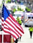 Flag flies at Boston Marathon finish line (AP Photo / Charles Krupa)