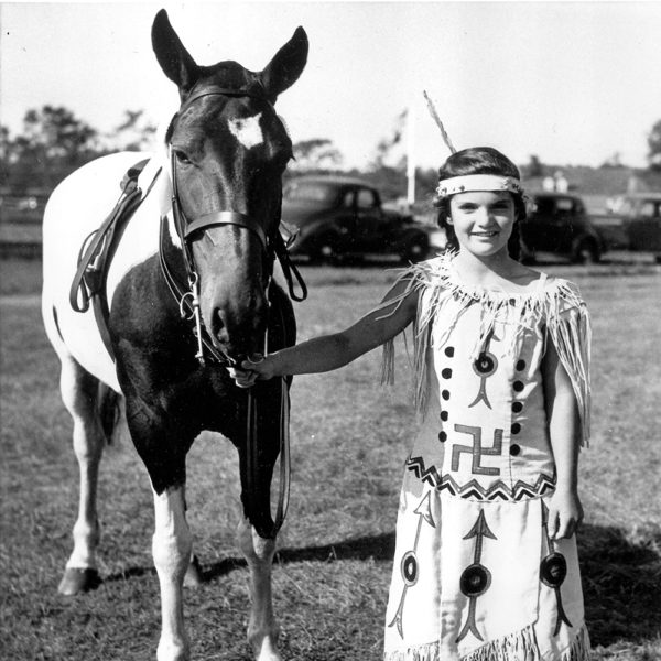 Young Jacqueline Bouvier with horse